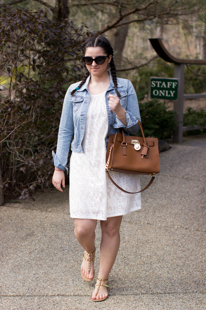 white lace dress, light wash denim jacket, cropped jean jacket, Michael kors, Michael kors Hamilton handbag, bcbg shoes, rockstud sandals, womens lace dress