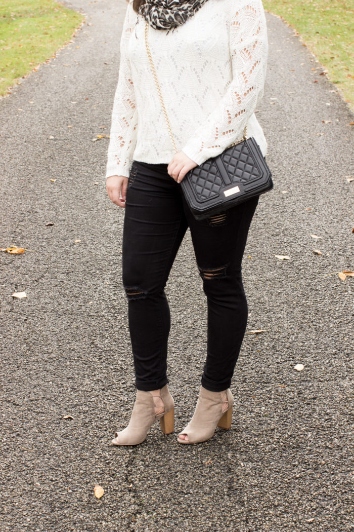 accessorizing with a leopard scarf, black skinny jeans, off white sweater,