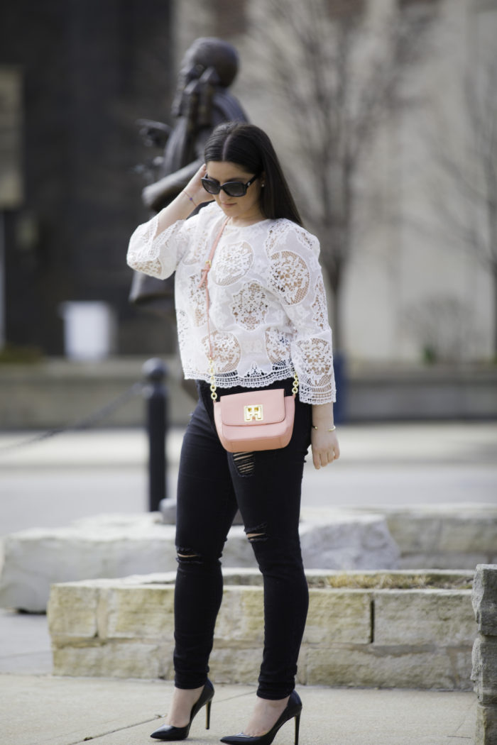 styling a white crochet top for Spring, bell sleeve lace top, black ripped skinny jeans, pink Tommy Hilfiger crossbody, nude bra,